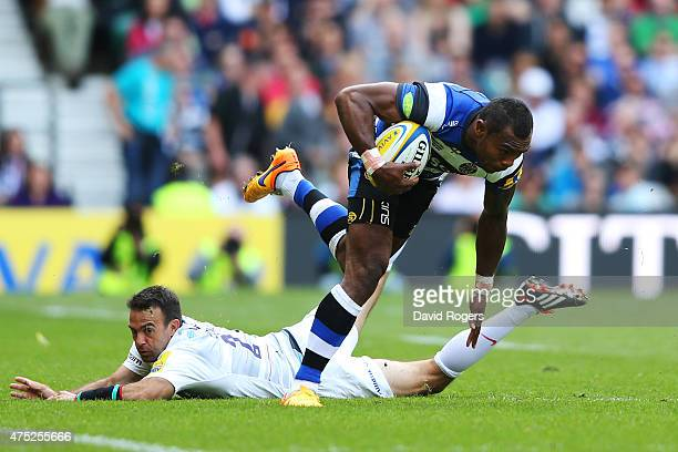 Semesa Rokoduguni of Bath goes through the tackle from Neil De Kock of Saracens during the Aviva Premiership Final between Bath Rugby and Saracens at...