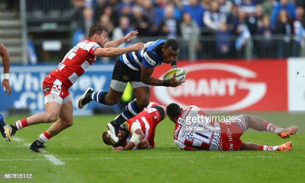 Semesa Rokoduguni of Bath is challenged by Henry Trinder and David Halaifonua of Gloucester during the Aviva Premiership match between Bath Rugby and...