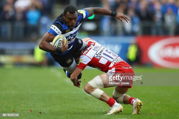 Semesa Rokoduguni of Bath is tackled by Billy Burns of Gloucester during the Aviva Premiership match between Bath Rugby and Gloucester Rugby at the...