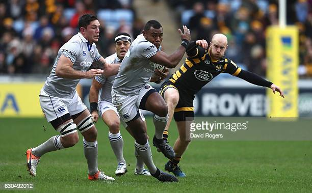 Semesa Rokoduguni of Bath moves away from Joe Simpson during the Aviva Premiership match between Wasps and Bath Rugby at The Ricoh Arena on December...