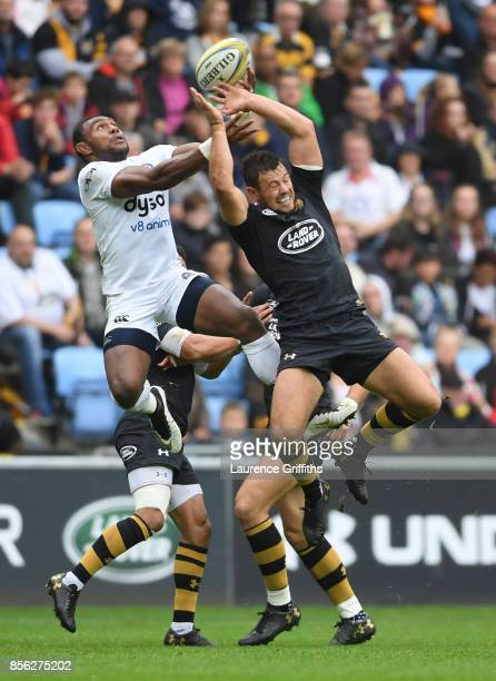 Semesa Rokoduguni of Bath rises for the ball with Rob Miller of Wasps during the Aviva Premiership match between Wasps and Bath Rugby at The Ricoh...