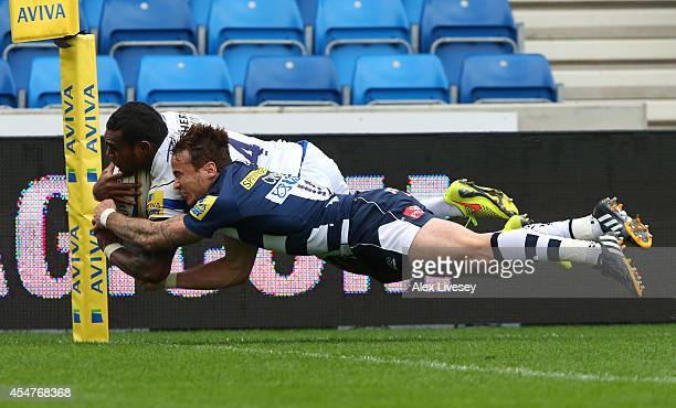 Semesa Rokoduguni of Bath Rugby beats Danny Cipriani of Sale Sharks to score a try during the Aviva Premiership match between Sale Sharks and Bath at...