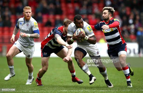 Semesa Rokoduguni of Bath Rugby is tackled by Jason Woodward and Jack Wallace of Bristol Rugby during the Aviva Premiership match between Bristol...