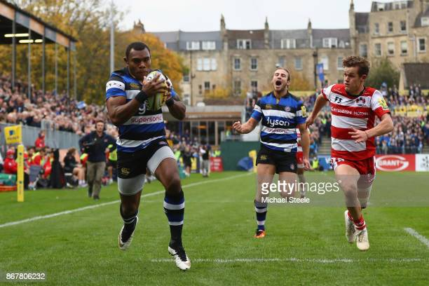 Semesa Rokoduguni of Bath scores his sides opening try as Billy Burns of Gloucester looks on during the Aviva Premiership match between Bath Rugby...