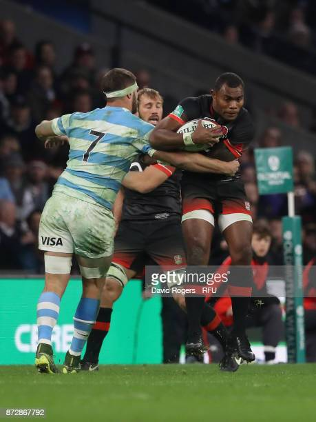Semesa Rokoduguni of England breaks the tackle of Marcos Kremer of Argentina during the Old Mutual Wealth Series match between England and Argentina...