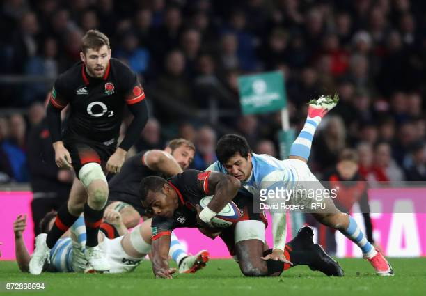 Semesa Rokoduguni of England is tackled during the Old Mutual Wealth Series match between England and Argentina at Twickenham Stadium on November 11...