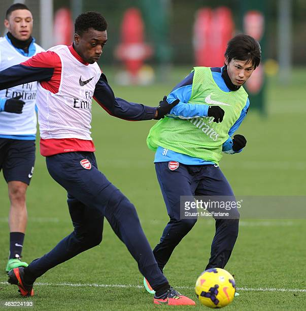 Semi Ajayi and Ryo Miyaichi compete for the ball during a training session at London Colney on January 17 2014 in St Albans England