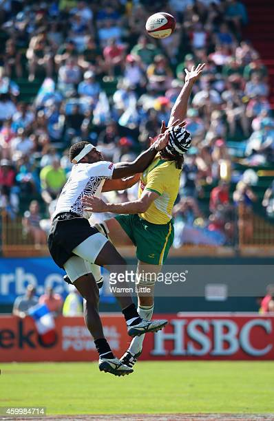 Semi Kunatani of Fiji and Juliano Fiori if Brazil jumpfor the ball during day one of the Emirates Dubai Sevens HSBC Sevens World Series on December 5...