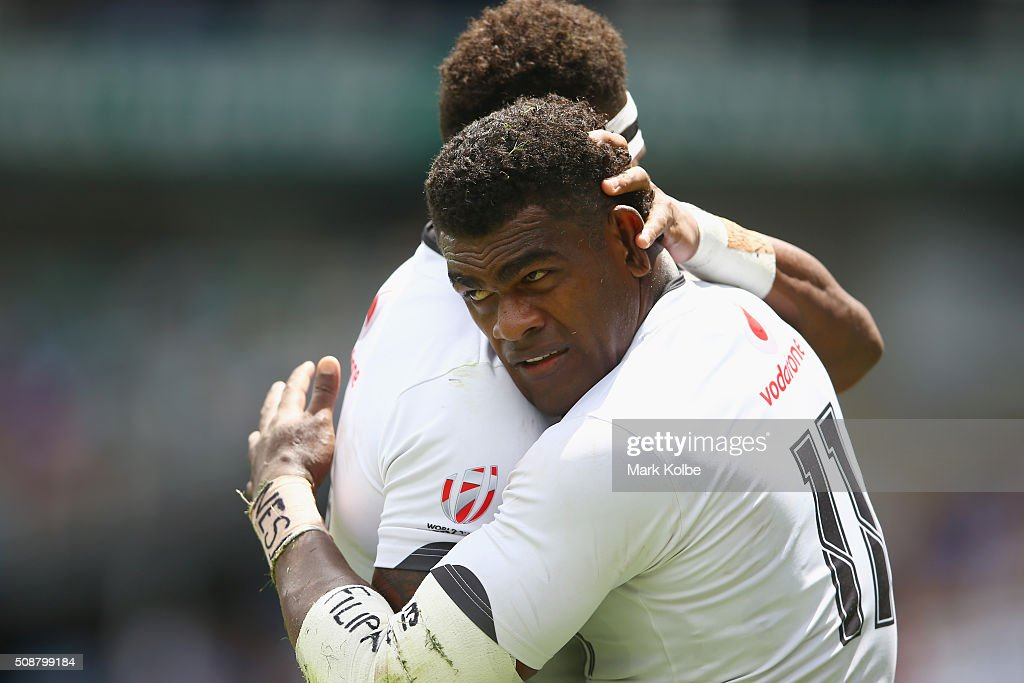 Semi Kunatani of Fiji congratulate Savenaca Rawaca of Fiji as he celebrates scoring a try during the 2016 Sydney Sevens cup quarter final match between Fiji and Kenya at Allianz Stadium on February 7, 2016 in Sydney, Australia.