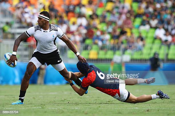 Semi Kunatani of Fiji is tackled by Masakatsu Hikosaka of Japan during the Men's Rugby Sevens semi final match between Fiji and Japan on Day 6 of the...