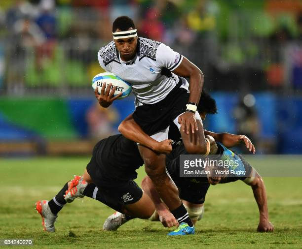 Semi Kunatani of Fiji is tackled by Reiko Ioane of New Zeland during the Men's Rugby Sevens quarter final match between Fiji and New Zealand on Day...