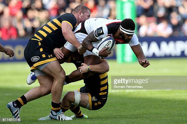 Semi Kunatani of Toulouse is tackled by during the European Rugby Champions Cup between Stade Toulousain and London Wasps at Stade Ernest Wallon on...