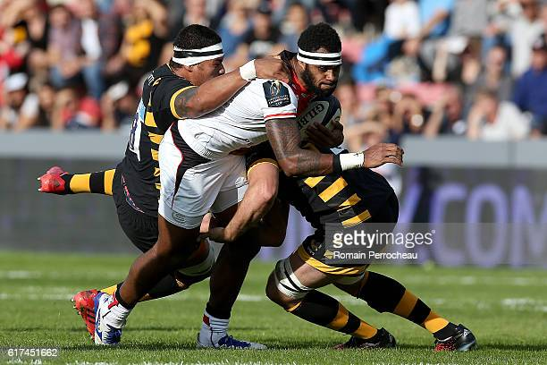 Semi Kunatani of Toulouse is tackled by Nathan Hugues of Wasps during the European Rugby Champions Cup between Stade Toulousain and London Wasps at...