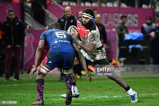 Semi Kunatani of Toulouse takes on Sekou Macalou of Stade Francais Paris during the Top 14 match between Stade Francais and Stade Toulousain on...