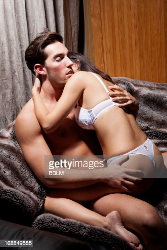 Semi Nude Couple Kissing On Couch Stock Photo | Getty Images