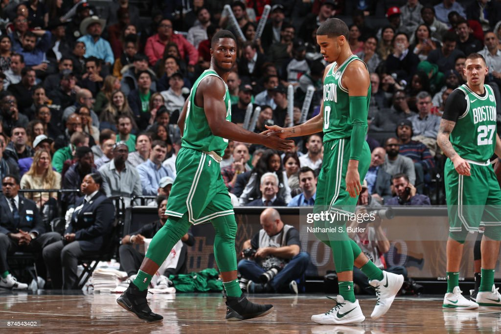 Semi Ojeleye #37 and Jayson Tatum #0 of the Boston Celtics shake hands against the Brooklyn Nets on November 14, 2017 at Barclays Center in Brooklyn, New York.