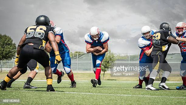 Semi Professional Football Players Running Down Field with Ball