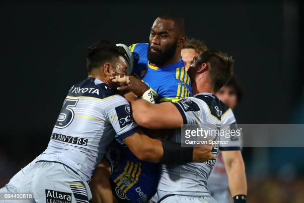 Semi Radrada of the Eels is tackled during the round 14 NRL match between the Parramatta Eels and the North Queensland Cowboys at TIO Stadium on June...
