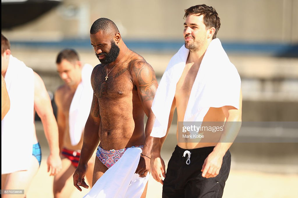 Semi Radradra and Aidan Guerra walk to the water during the Australia Kangaroos Test team recovery session at Coogee Beach on May 2, 2016 in Sydney, Australia.