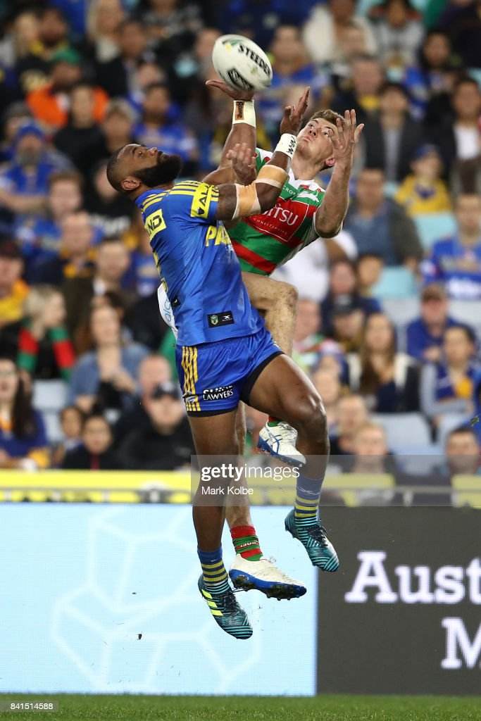 Semi Radradra of the Eels and Campbell Graham of the Rabbitohs compete for the ball during the round 26 NRL match between the Parramatta Eels and the South Sydney Rabbitohs at ANZ Stadium on September 1, 2017 in Sydney, Australia.