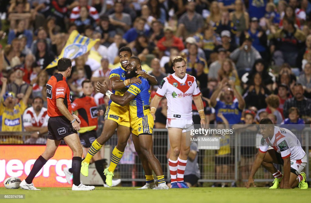 Semi Radradra of the Eels celebrates scoring a try with team mate Michael Jennings during the round two NRL match between the St George Illawarra Dragons and the Parramatta Eels at WIN Stadium on March 12, 2017 in Wollongong, Australia.