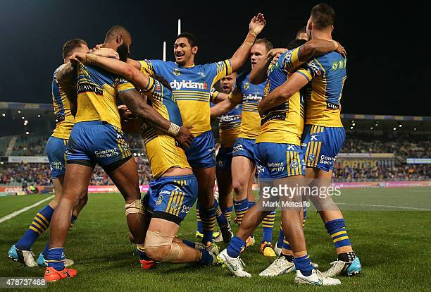 Semi Radradra of the Eels celebrates scoring a try with team mates during the round 16 NRL match between the Parramatta Eels and the St George...