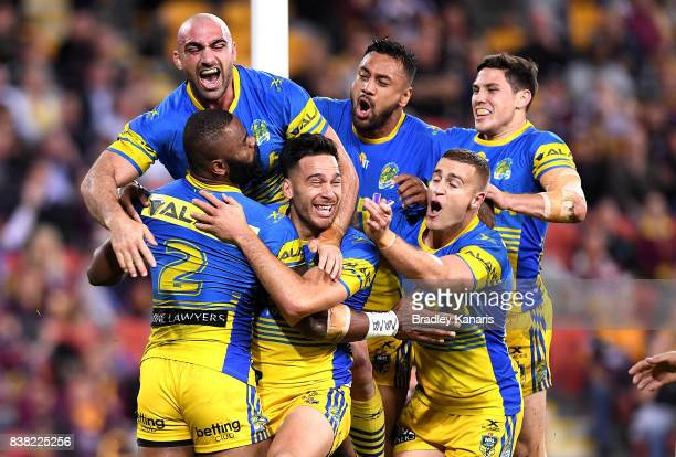 Semi Radradra of the Eels is congratulated by team mates after scoring a try during the round 25 NRL match between the Brisbane Broncos and the...