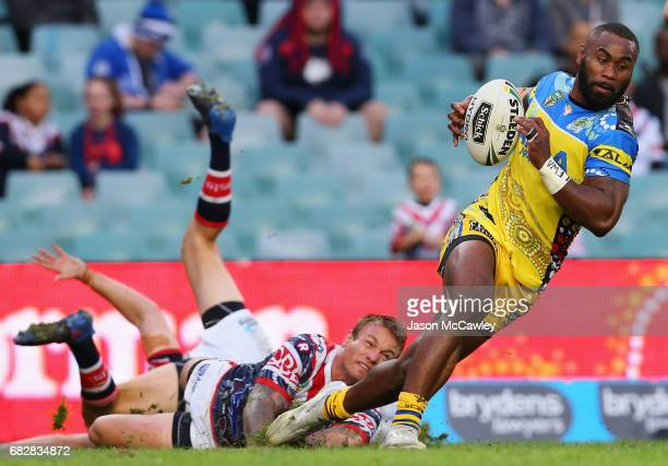 Semi Radradra of the Eels is tackled during the round 10 NRL match between the Sydney Roosters and the Parramatta Eels at Allianz Stadium on May 14...