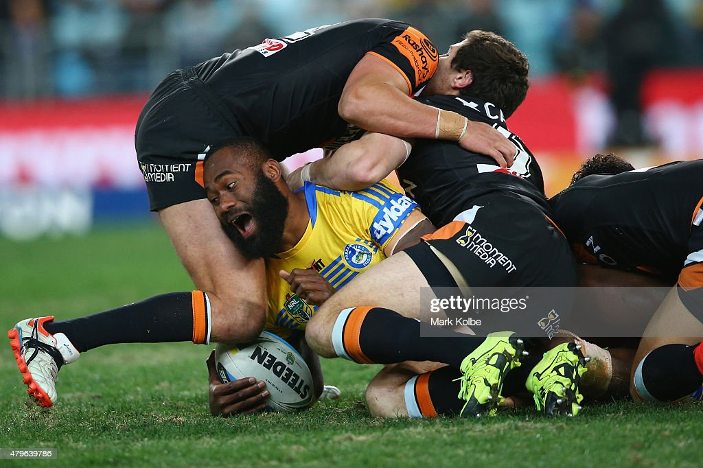 Semi Radradra of the Eels is tackled during the round 17 NRL match between the Wests Tigers and the Parramatta Eels at ANZ Stadium on July 6, 2015 in Sydney, Australia.