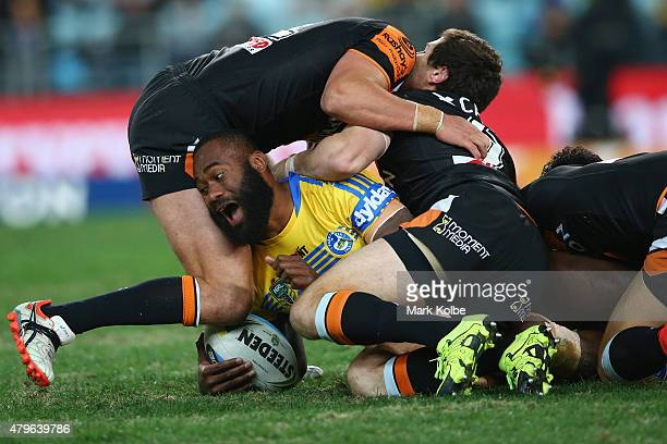 Semi Radradra of the Eels is tackled during the round 17 NRL match between the Wests Tigers and the Parramatta Eels at ANZ Stadium on July 6 2015 in...