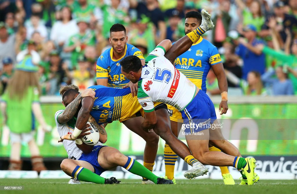 Semi Radradra of the Eels is tackled during the round five NRL match between the Canberra Raiders and the Parramatta Eels at GIO Stadium on April 1, 2017 in Canberra, Australia.