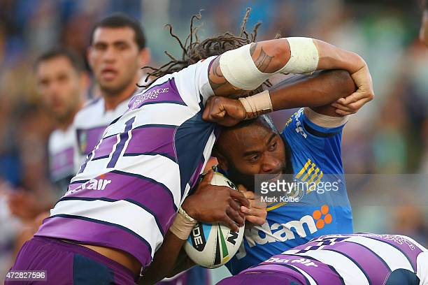 Semi Radradra of the Eels is tackled during the round nine NRL match between the Parramatta Eels and the Melbourne Storm at Pirtek Stadium on May 10...