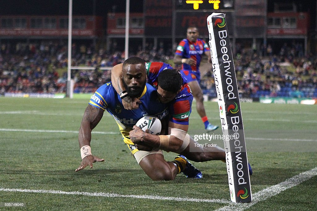 <a gi-track='captionPersonalityLinkClicked' href=/galleries/search?phrase=Semi+Radradra&family=editorial&specificpeople=7896121 ng-click='$event.stopPropagation()'>Semi Radradra</a> of the Eels scores a try during the round 12 NRL match between the Newcastle Knights and the Parramatta Eels at Hunter Stadium on May 30, 2016 in Newcastle, Australia.