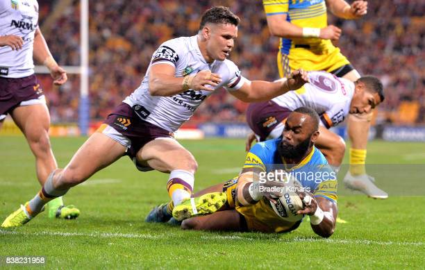 Semi Radradra of the Eels scores a try during the round 25 NRL match between the Brisbane Broncos and the Parramatta Eels at Suncorp Stadium on...