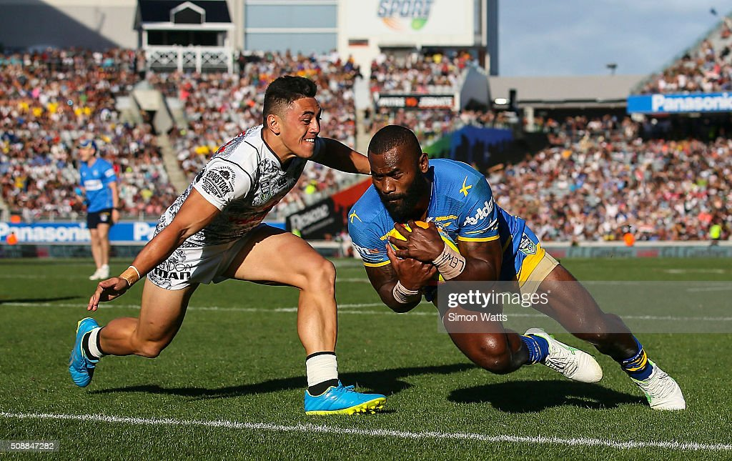 Semi Radradra of the Eels scores a try in the tackle of Nathaniel Roache of the Warriors during the 2016 Auckland Nines Grand Final match between the Warriors and the Eels at Eden Park on February 7, 2016 in Auckland, New Zealand.