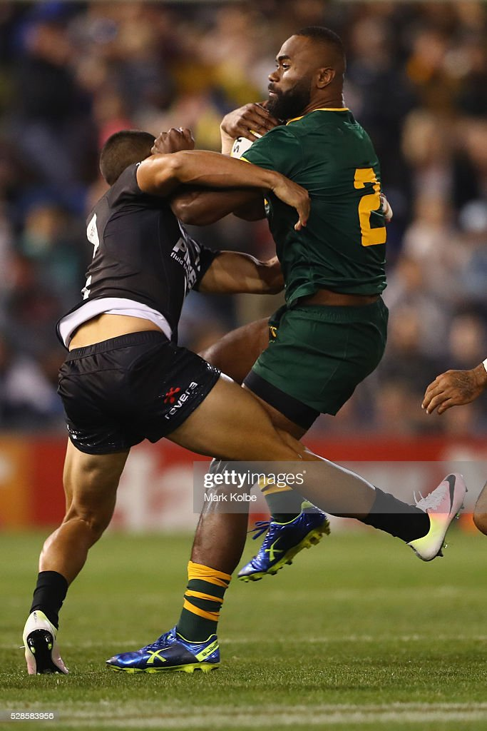 <a gi-track='captionPersonalityLinkClicked' href=/galleries/search?phrase=Semi+Radradra&family=editorial&specificpeople=7896121 ng-click='$event.stopPropagation()'>Semi Radradra</a> of the Kanagroos is tackled during the International Rugby League Trans Tasman Test match between the Australian Kangaroos and the New Zealand Kiwis at Hunter Stadium on May 6, 2016 in Newcastle, Australia.
