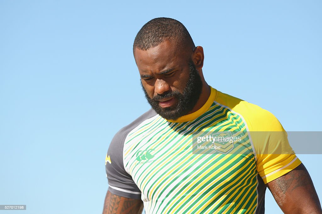 <a gi-track='captionPersonalityLinkClicked' href=/galleries/search?phrase=Semi+Radradra&family=editorial&specificpeople=7896121 ng-click='$event.stopPropagation()'>Semi Radradra</a> watches on during the Australia Kangaroos Test team recovery session at Coogee Beach on May 2, 2016 in Sydney, Australia.