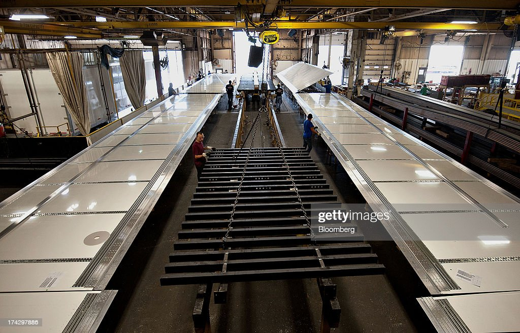 A semi trailer frame section is positioned between two rows of side panels during assembly at the Wabash National Corp. facility in Lafayette, Indiana, U.S., on Monday, July 22, 2013. Wabash National Corp. is scheduled to release earnings figures on July 30. Photographer: Daniel Acker/Bloomberg via Getty Images
