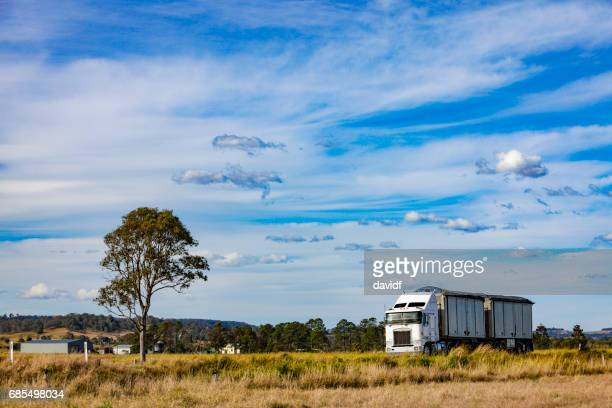 Semi Trailer Truck Delivering on a Rural Country Highway