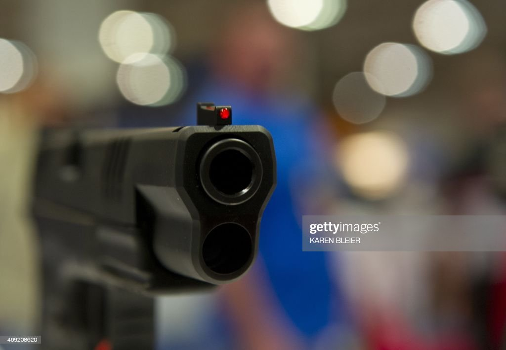 A semiautomatic handgun is displayed at the 2015 NRA Annual Convention in Nashville Tennessee on April 10 2015 The annual NRA meeting and exhibit...