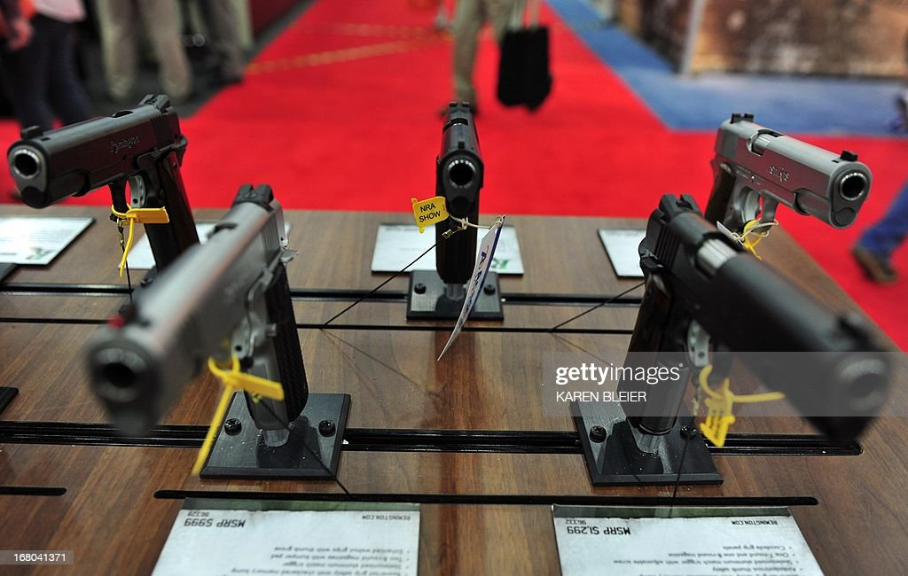 Semiautomatic handguns are seen at the NRA Convention on May 4 2013 in Houston Texas AFP PHOTO / Karen BLEIER