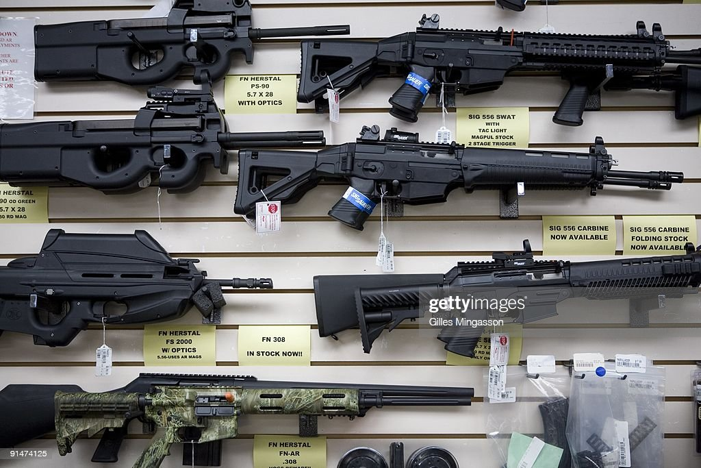 Semiautomatic weapons for sale are on display at Texas Gun one of the 6700 gun dealers located near the 2000 miles long USMexico border where Gina...
