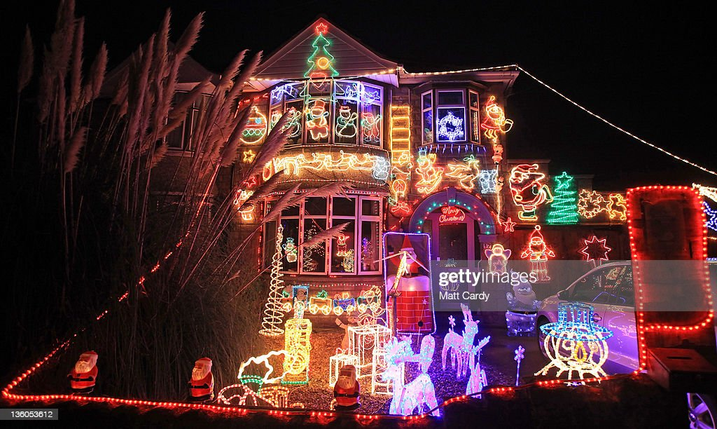 A Semi Detached House Is Lit Up With Exterior Christmas Lights On December  16,