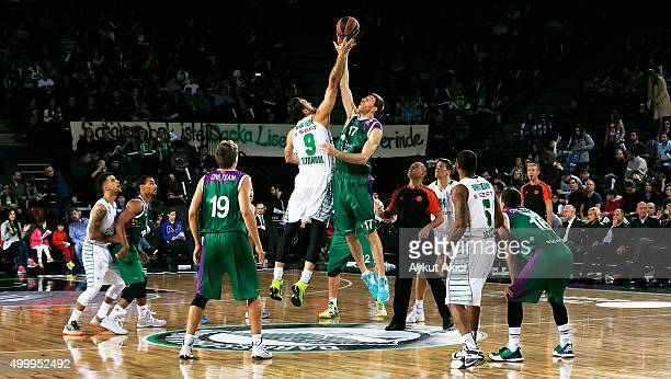 Semih Erden #9 of Darussafaka Dogus Istanbul competes with Fran Vazquez #17 of Unicaja Malaga during the Turkish Airlines Euroleague Basketball...