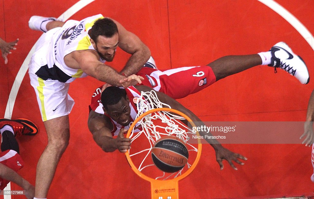 Semih Erden, #9 of Fenerbahce Ulker Istanbul competes with Bryant Dunston, #6 of Olympiacos Piraeus during the Turkish Airlines Euroleague Basketball Top 16 Date 10 game between Olympiacos Piraeus v Fenerbahce Ulker Istanbul at Peace and Friendship Stadium on March 13, 2015 in Athens, Greece.