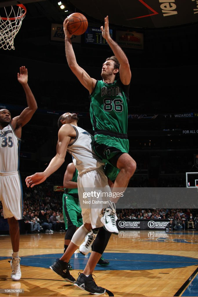 Semih Erden of the Boston Celtics shoots against JaVale McGee of the Washington Wizards at the Verizon Center on January 22 2011 in Washington DC...