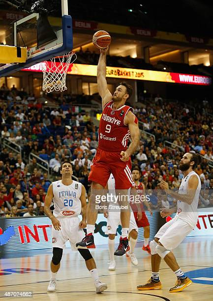 Semih Erden of Turkey dunks the ball during the FIBA EuroBasket 2015 Group B basketball match between Italy and Turkey at Arena of EuroBasket 2015 on...