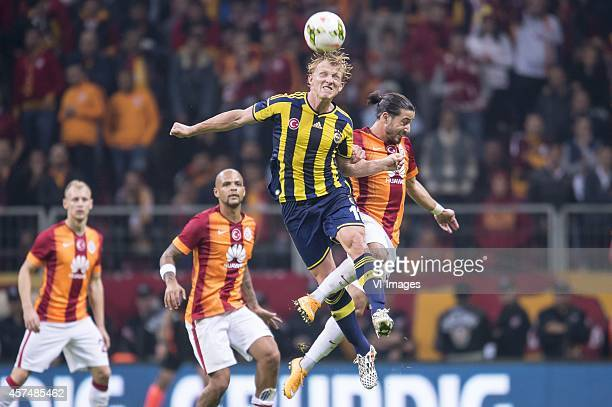 Semih Kaya of Galatasaray Felipe Melo of Galatasaray Dirk Kuijt of Fenerbahce Aydin Yilmaz of Galatasaray during the Turkish SuperLig match between...
