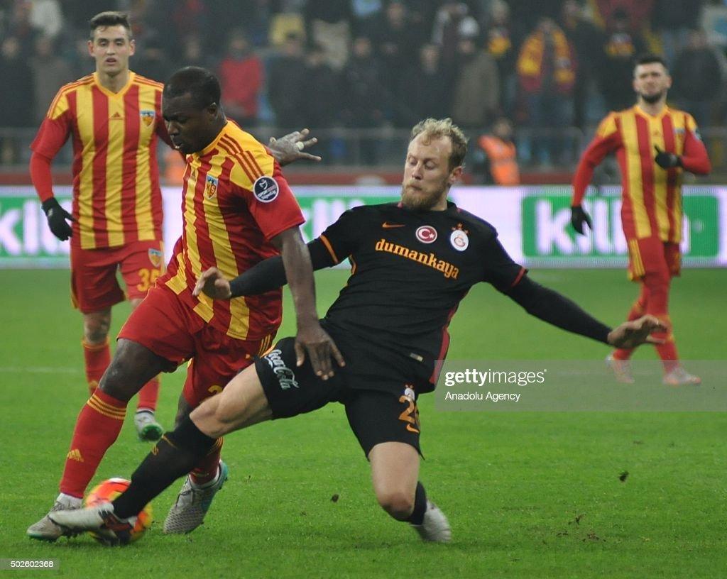 Semih Kaya of Galatasaray in action against Yakubu Aiyegbeni of Kayserispor during Turkish Spor Toto Super Lig football match between Kayserispor and...
