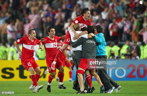 Semih Senturk of Turkey is mobbed by team mates after he scores in the last minute of extra time during the UEFA EURO 2008 Quarter Final match...